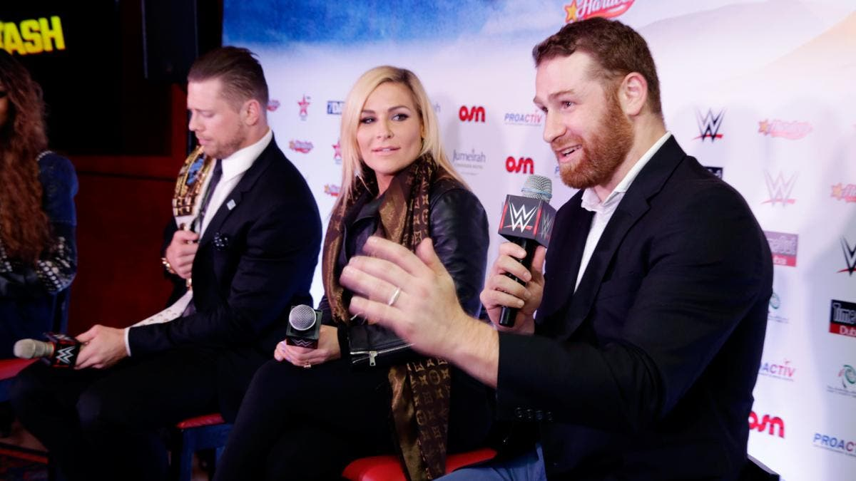 Zayn alongside Intercontinental champion The Miz (L) and Diva star Natalia (C) at a press conference in Dubai. (WWE)