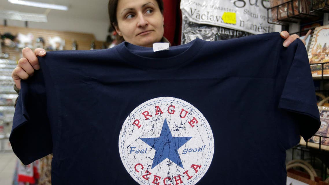 A vendor displays a t-shirt with the word 'Czechia' in a store in Prague, Czech Republic, Thursday, April 14, 2016. (AP)