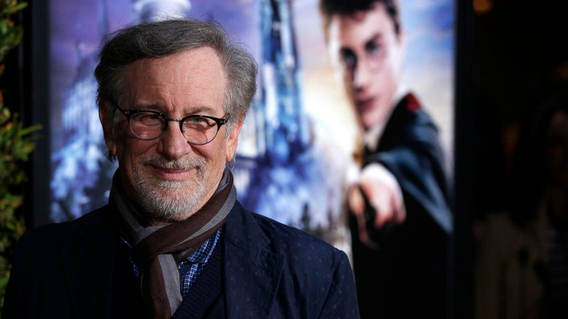 """Director Steven Spielberg poses as he arrives for a special preview opening of """"The Wizarding World of Harry Potter"""" attraction at Universal Studios Hollywood in Universal City, California April 5, 2016."""
