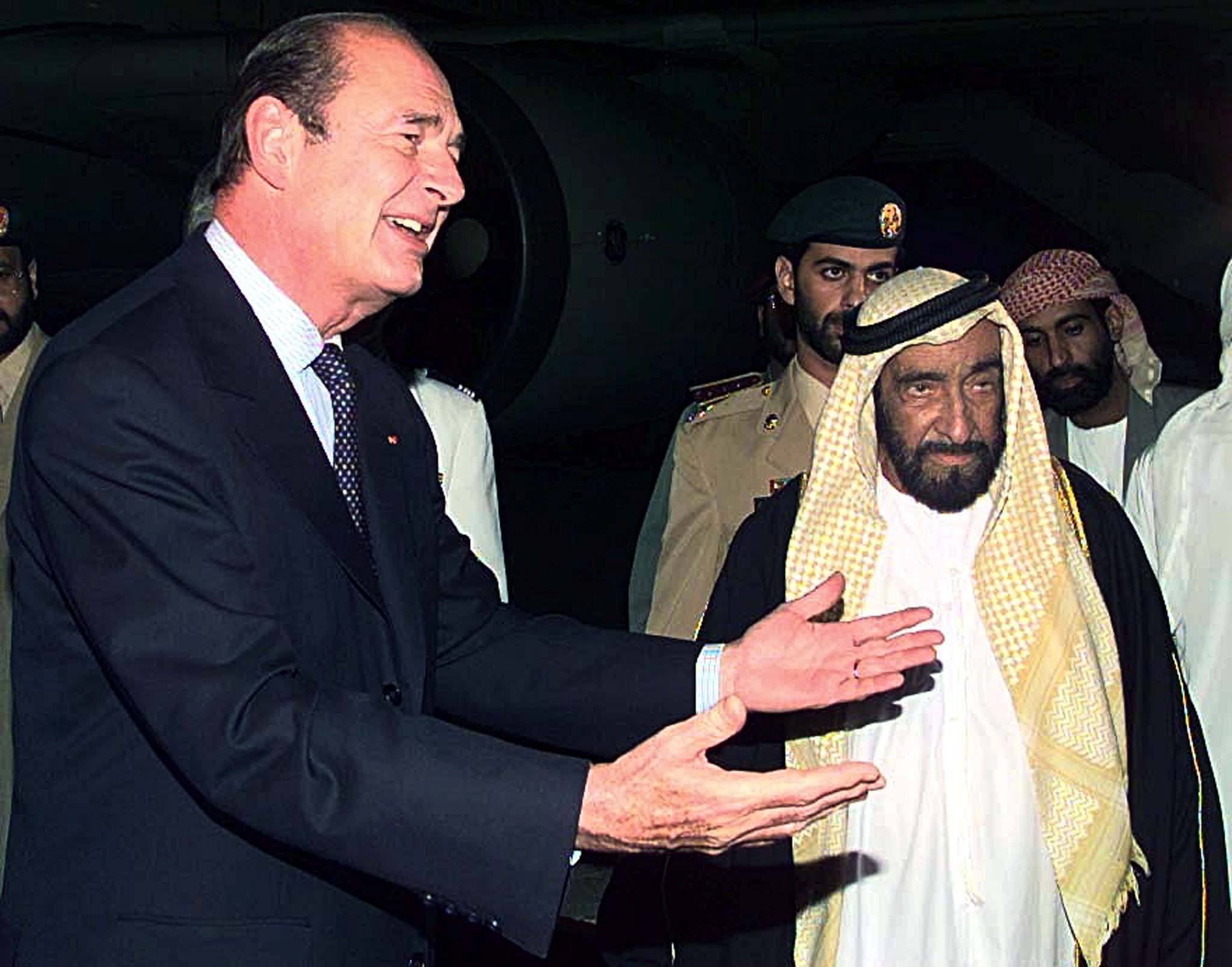 French President Jacques Chirac (L) gestures beside Sheikh Zayed bin Sultan al-Nahayan, the Late President of the United Arab Emirates. (File photo: Reuters)