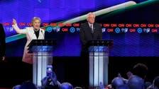 Clinton, Sanders spar in uproarious debate