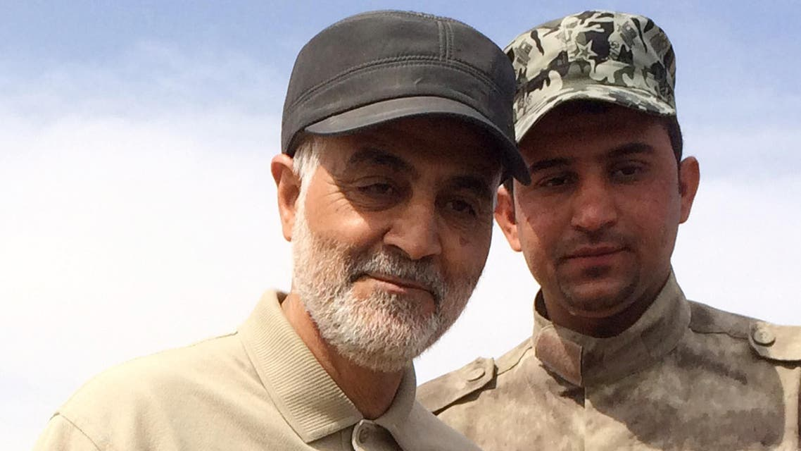 Iranian Revolutionary Guard Commander Qassem Soleimani (L) stands at the frontline during offensive operations against Islamic State militants in the town of Tal Ksaiba in Salahuddin province March 8, 2015. (Reuters)