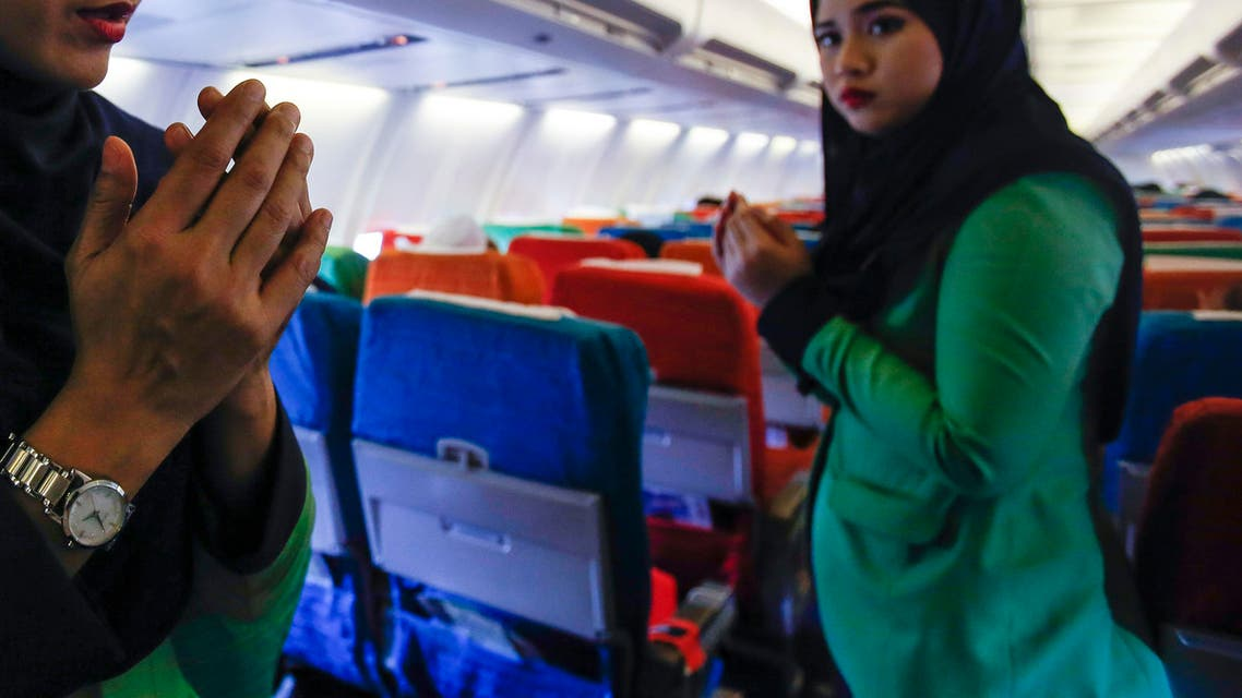 Happier days In this Dec. 22, 2015, photo, a Rayani Air flight crew walks down the aisle on board before departure at Kuala Lumpur International Airport 2 in Sepang, Malaysia. (AP)
