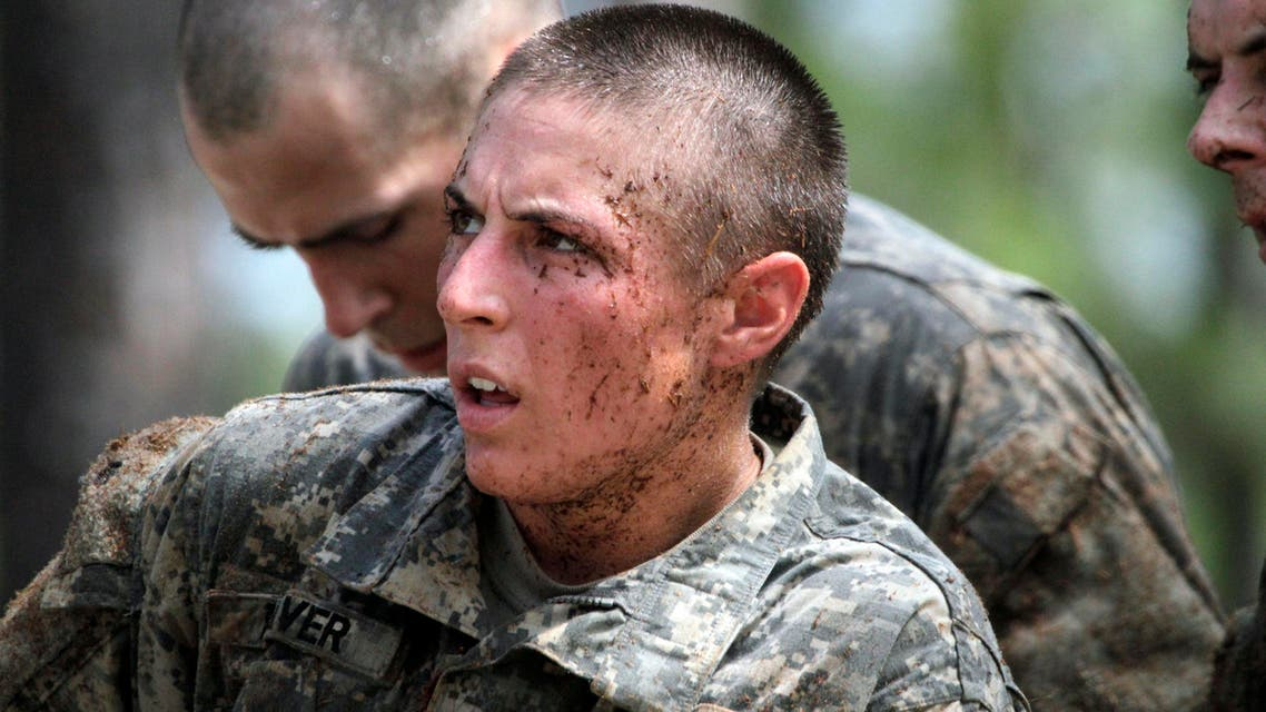 In this photo taken on April 26, 2015, one of the 20 female soldiers takes part in a obstacle course at an army base (AP)