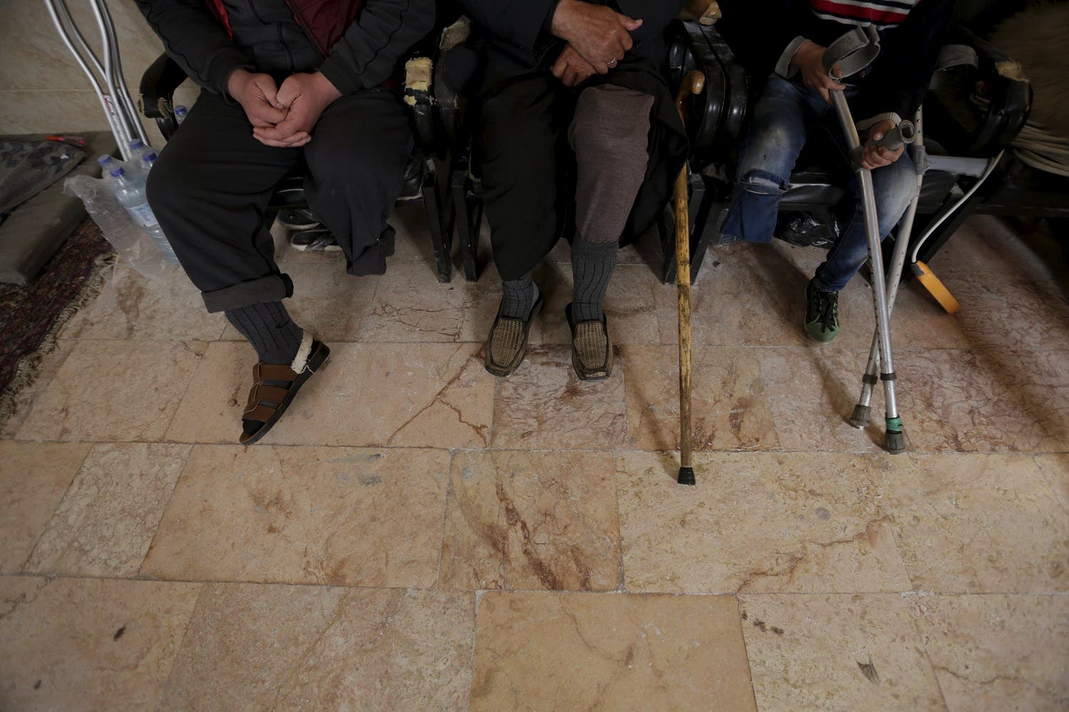 Men with amputated limbs wait to be inspected in the rebel-controlled area of Maaret al-Numan town in Idlib province, Syria March 20, 2016. REuter