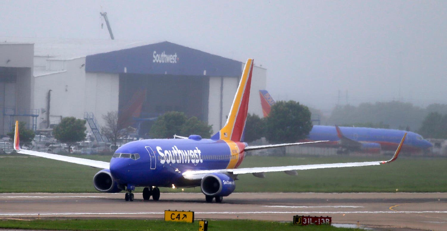 A Southwest airlines jet taxis before taking off from a runway at Love Field in Dallas, Thursday, April 23, 2015. (AP