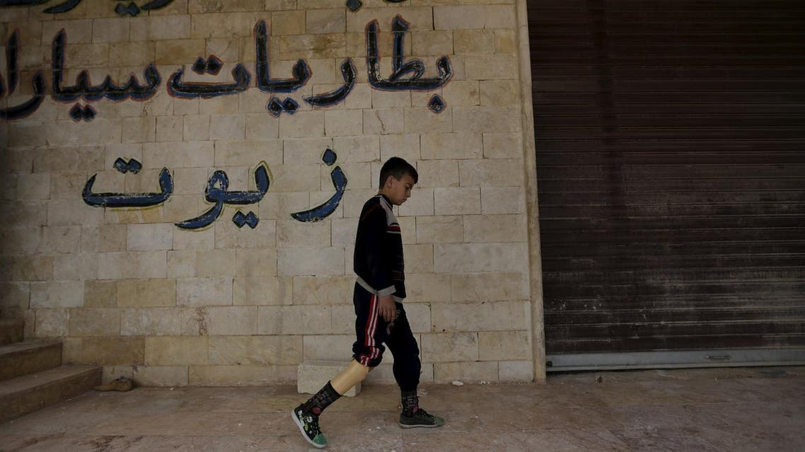 A boy with an amputated leg walks using an artificial limb in the rebel-controlled area of Maaret al-Numan town in Idlib province, Syria March 20, 2016. Reuters