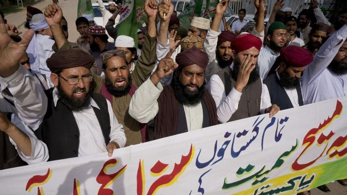 "Activists of Pakistani religious group Sunni Tehreek demanding executions of court sentences given under the blasphemy law, during a protest in Rawalpindi, Pakistan, Friday, April 15, 2016. Banner reads ""court sentences awarded to all blasphemers including Asia, should be implemented. "" Asia Bibi, a Christian woman sentenced for death for blasphemy (AP)"