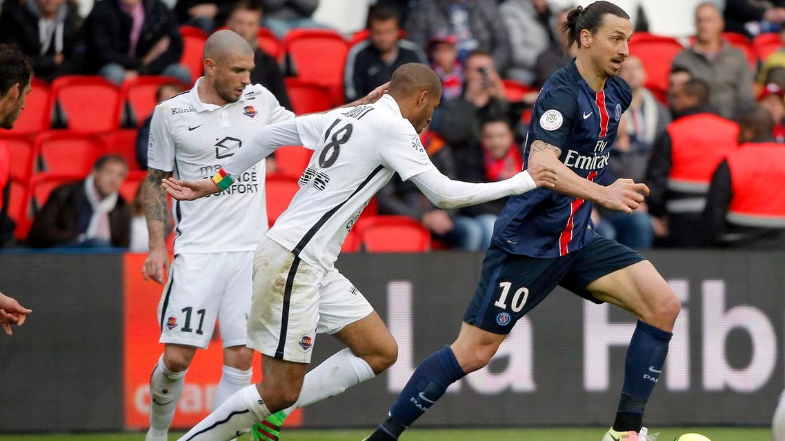 PSG's Zlatan Ibrahimovic, right, challenges for the ball with Caen's Jordan Adeotti during their French League One soccer match between PSG and Caen at the Parc des Princes stadium in Paris, France, Saturday, April 16, 2016. (AP)