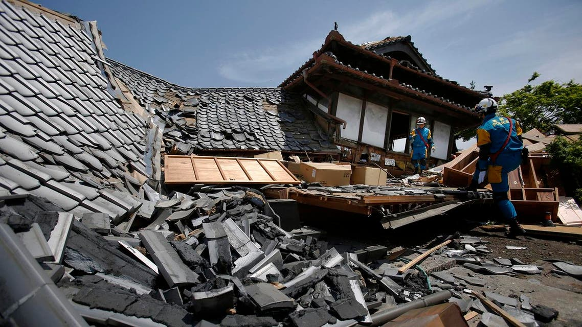 Police rescue team members check for the possibility of trapped people in collapsed houses in Mashiki, Kumamoto prefecture, southern Japan, Friday, April 15, 2016, after an unusually strong overnight earthquake. (AP)