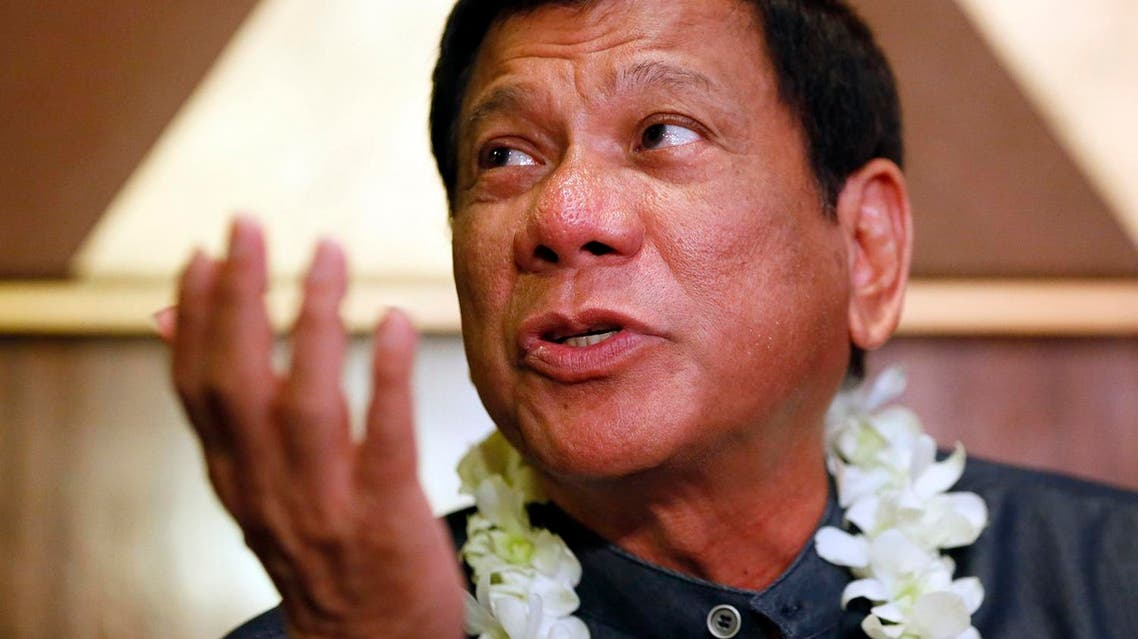 """In this March 10, 2016 photo, Davao City Mayor Rodrigo Duterte talks to the media prior to addressing seafarers organization in Manila, Philippines. Nicknamed """"Duterte Harry,"""" after a Clint Eastwood character with little regard for rules, the Philippine city mayor casually threatens to shoot criminals, hang them like dirty laundry or drown them in Manila Bay. His expletives have sideswiped even the deeply revered pope. Despite such brazen talk, Rodrigo Duterte has emerged as a top contender in Philippine presidential elections on May 9 in an impressive political rise that has been likened to Donald Trump's. The tough-talking mayor finds the comparison offensive and draws the line. (AP Photo/Bullit Marquez)"""