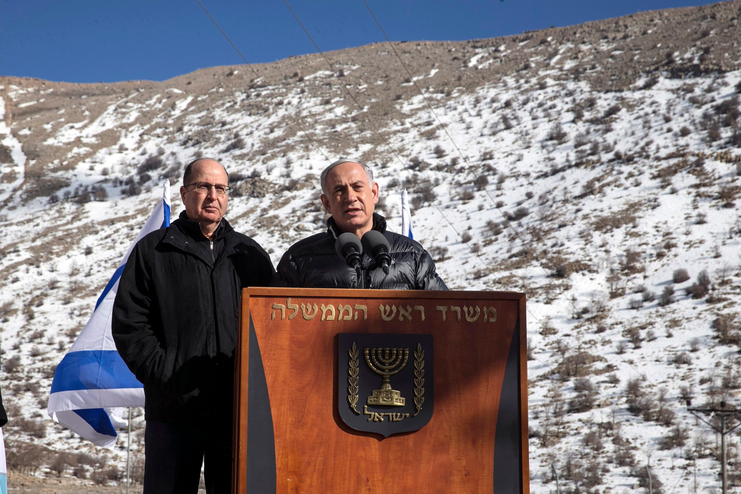 Israel's Prime Minister Benjamin Netanyahu (R) speaks next to Defence Minister Moshe Yaalon during a visit to Mount Hermon in the Golan Heights near the Israel-Syria border February 4, 2015. (Reuters)