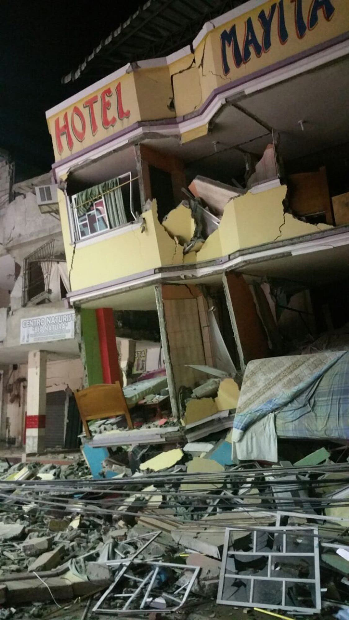 An hotel barely stands after an earthquake in the town of Manta, Ecuador, Saturday April 16, 2016. A powerful, 7.8-magnitude earthquake shook Ecuador's central coast on Saturday, killing at least 28 people and spreading panic hundreds of kilometers (miles) away as it collapsed homes and buckled a major overpass.(AP Photo/Patricio Ramos)