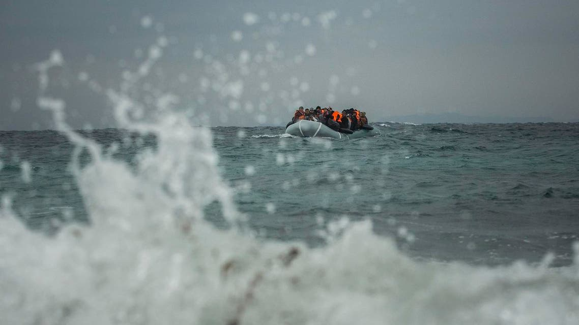 Refugees and migrants aboard a dinghy approach the Greek island of Lesbos, on Sunday, Jan. 3, 2016. More than a million people reached Europe in 2015 in the continent's largest refugee influx since the end of World War II. Nearly 3,800 people are estimated to have drowned in the Mediterranean last year, making the journey to Greece or Italy in unseaworthy vessels packed far beyond capacity. (AP Photo/Santi Palacios)