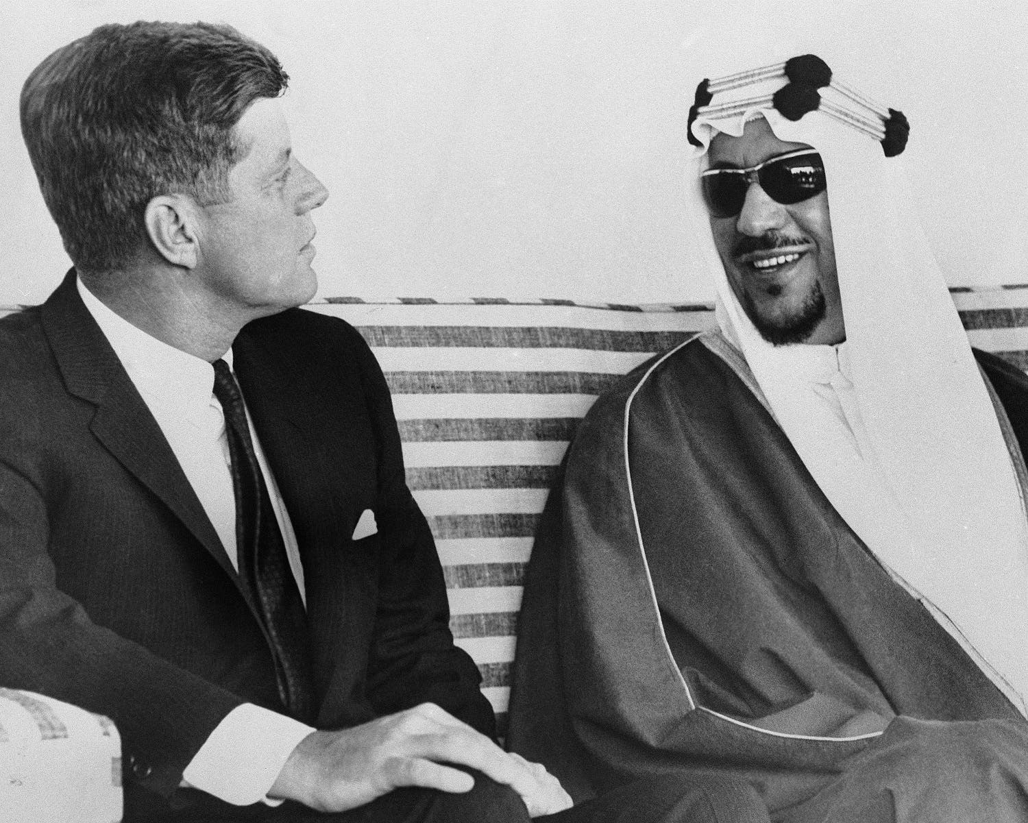 President John F. Kennedy and King Saud of Saudi Arabia, have informal talk on the patio of King Saud's ocean front mansion in Palm Beach, Florida Jan. 27, 1962. (File Photo: AP)