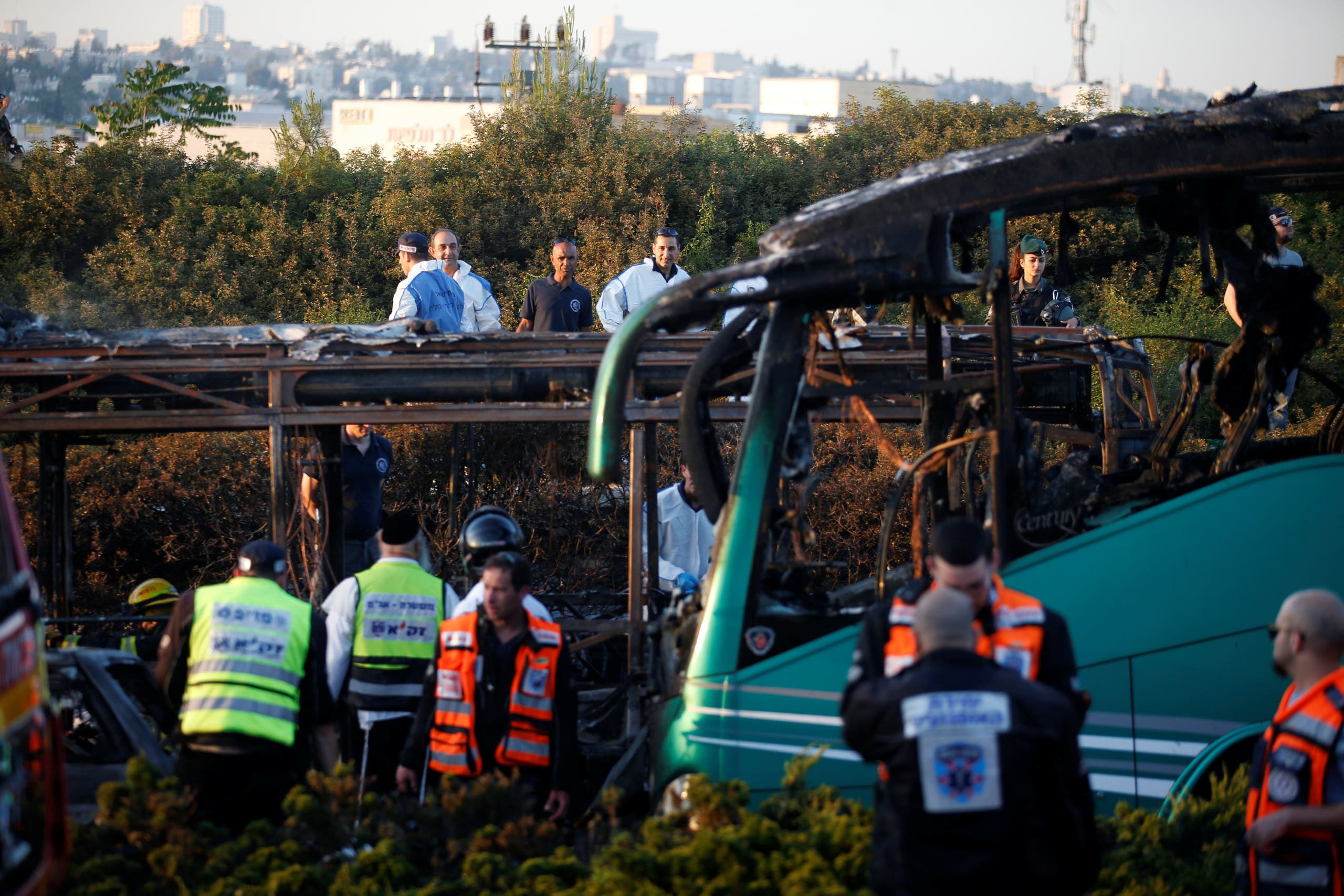 Emergency workers search the scene after a blast on a bus in Jerusalem April 18, 2016. REUTERS