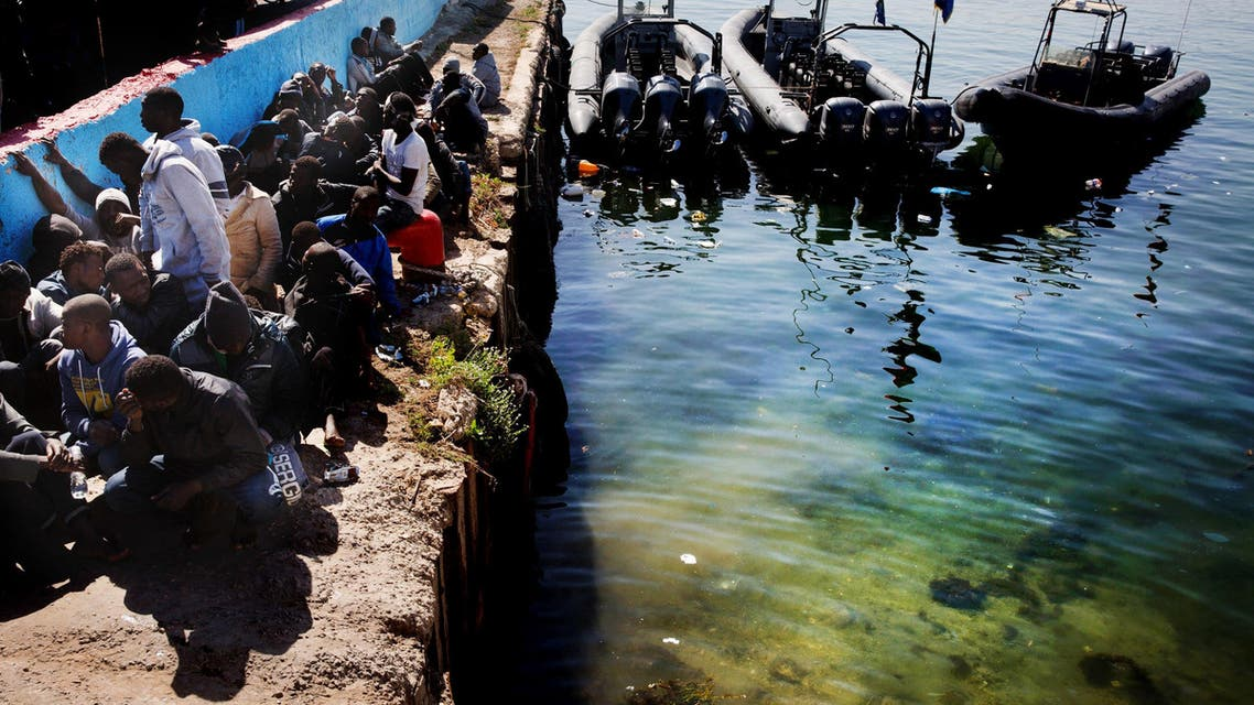 African illegal migrants wait to receive medial assistance after being rescued by coastal guards on a port in Tripoli, Libya, Monday, April 11, 2016. AP