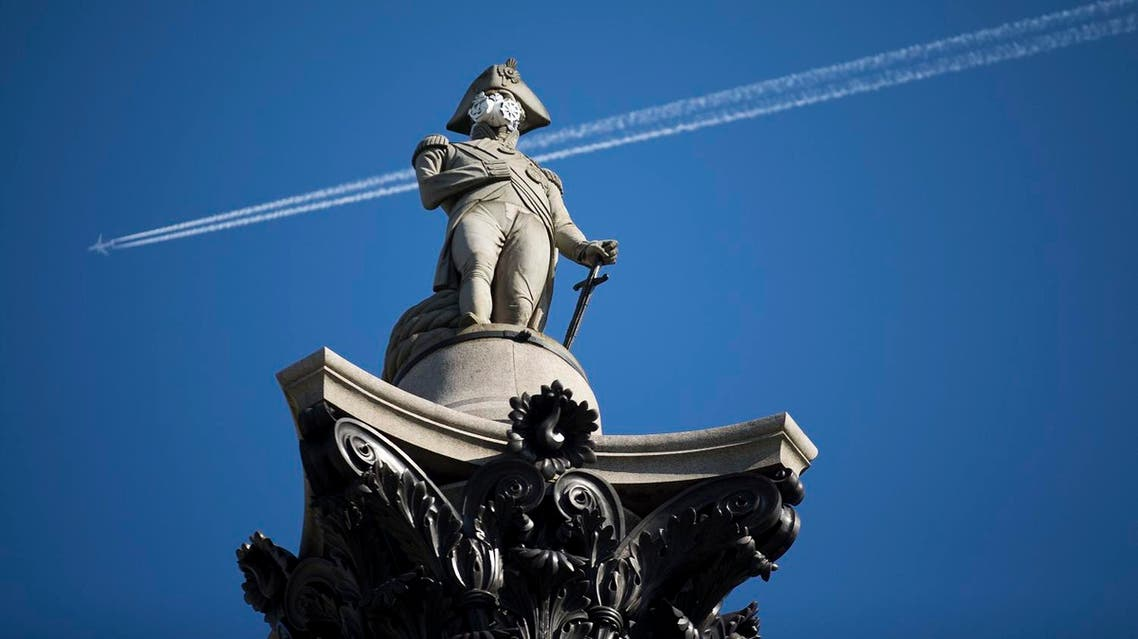 A clean air mask is seen placed on the top of Nelson's Column by Greenpeace activists to protest against air pollution quality in London (Photo: AP)