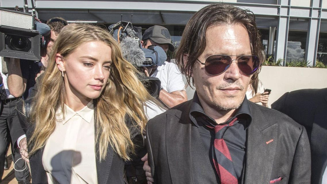 Actor Johnny Depp (R) and wife Amber Heard arrive at the Southport Magistrates Court on Australia's Gold Coast, April 18, 2016. Hollywood actor Johnny Depp's wife, actress Amber Heard, appeared in the Queensland court Monday charged with illegally smuggling the couple's Yorkshire terriers, Pistol and Boo, into the country on a private jet while Depp was shooting a Pirates of the Caribbean movie last year. (Reuters/Dave Hunt/AAP