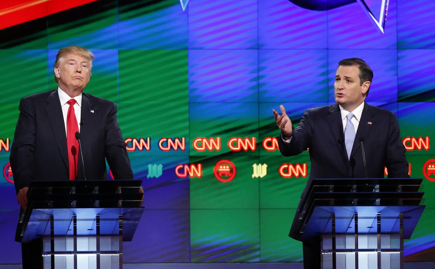 Republican presidential candidate, Sen. Ted Cruz, R-Texas, speaks as Republican presidential candidate, businessman Donald Trump listens, during the Republican presidential debate sponsored by CNN, Salem Media Group and the Washington Times at the University of Miami, Thursday, March 10, 2016, in Coral Gables, Fla. (AP)
