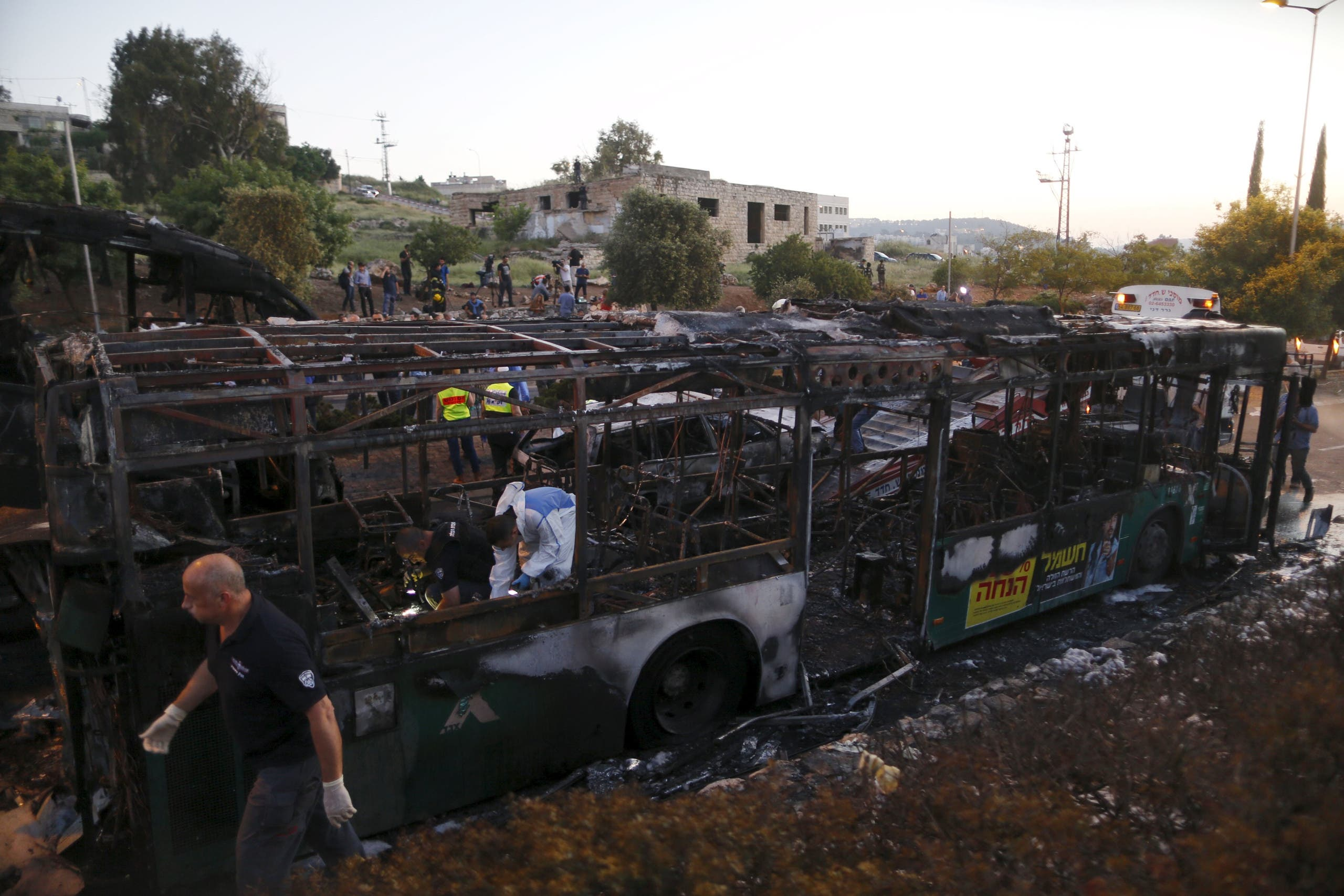 Israeli police forensic experts work at the scene after an explosion tore through a bus in Jerusalem on Monday REUTERS