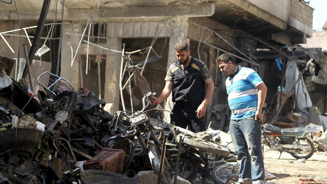 Men inspect damaged motorcycles after an airstrike on a market on a town in the insurgent stronghold of Idlib province, Syria April 19, 2016. (Reuters)