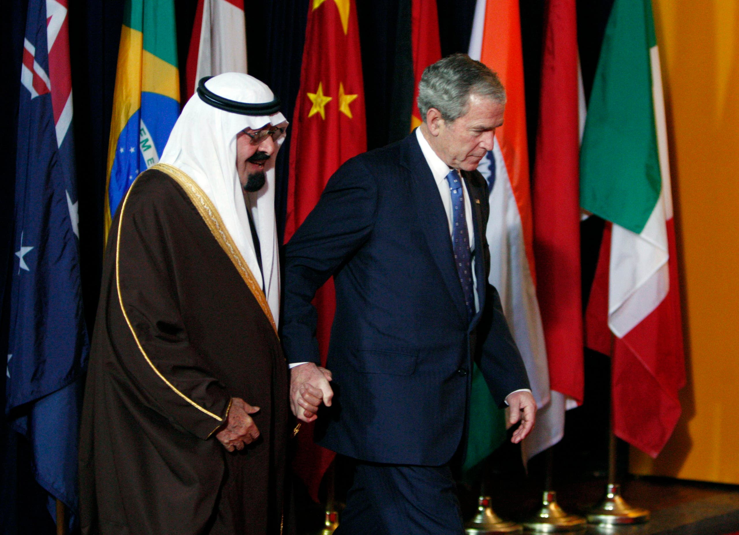 U.S. President George W. Bush (R) escorts Saudi Arabia's King Abdullah into the group photo at the G20 Summit on Financial Markets and the World Economy at the National Building Museum in Washington, November 15, 2008.