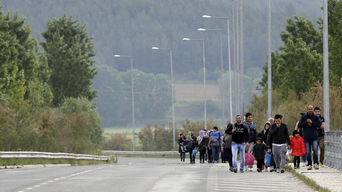 Afghan migrants walk towards the northern Greek border point of Idomeni, Greece, Tuesday, April 19, 2016 (AP)