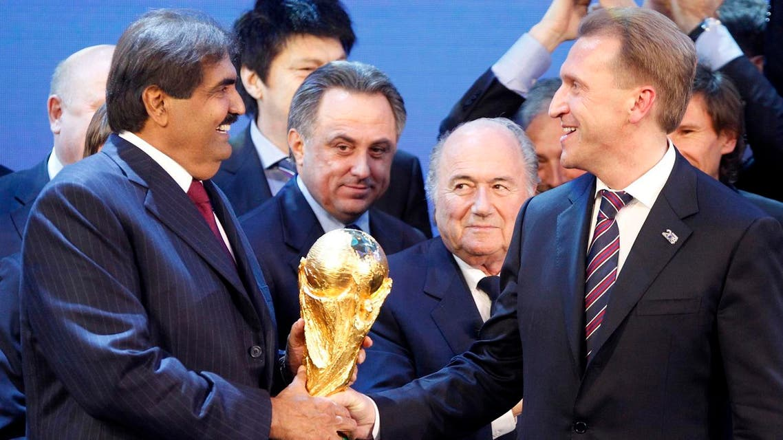 FIFA President Joseph Blatter, 2nd right, is flanked by Russian Deputy Prime Minister Igor Shuvalov, right, and Sheikh Hamad bin Khalifa Al-Thani, Emir of Qatar, left, after the announcement that Russia will be the host country for the soccer World Cup 2018 and Qatar the host for the tournament in 2022 in Zurich, Switzerland, Thursday, Dec.2, 2010. Left is Russian national team player Andrei Arshavin. (AP)