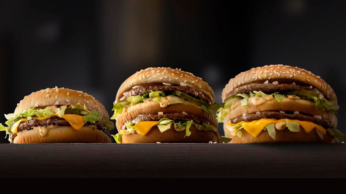 This photo provided by McDonald's shows, from left to right: McDonald's Mac Jr., Big Mac and Grand Mac. McDonald's is testing bigger and smaller versions of its Big Mac as the world's biggest hamburger chain pushes to revive its business. The company says it's testing the Grand Mac and Mac Jr. in the Central Ohio and the Dallas areas, and will see how they do before deciding on a national rollout. (McDonald's via AP)