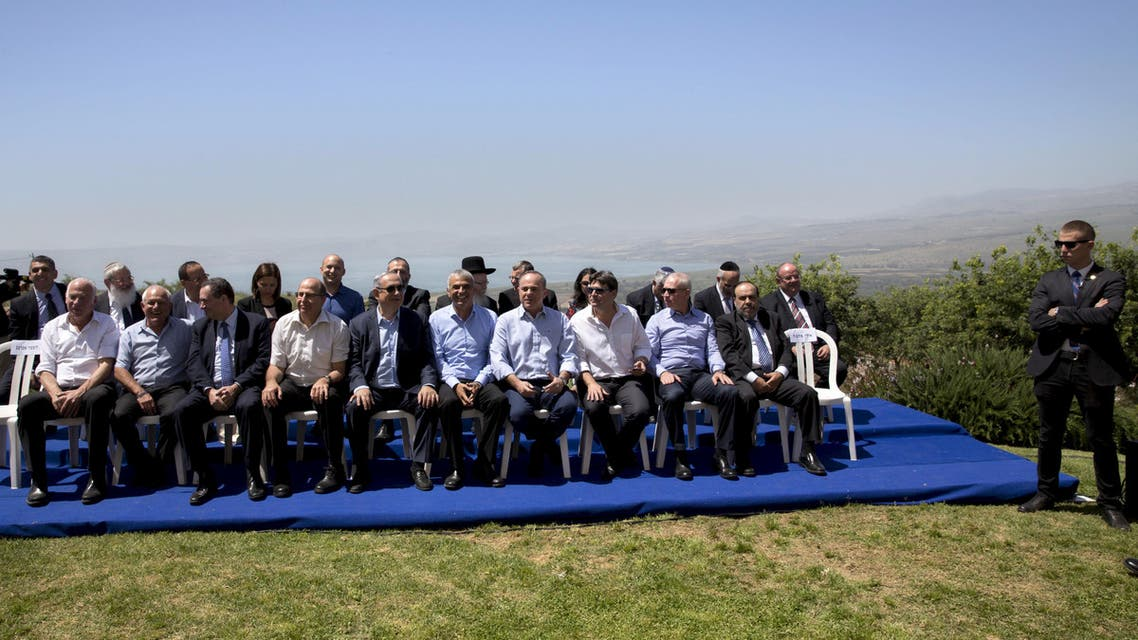 Israeli Prime Minister Benjamin Netanyahu (5th L, front row) poses with ministers prior to the weekly cabinet meeting in the Israeli occupied Golan Heights near the ceasefire line between Israel and Syria, April 17, 2016