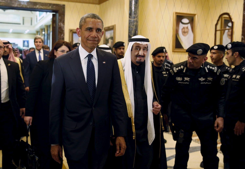 U.S. President Barack Obama (L) walks with Saudi Arabia's King Salman to a meeting at Erga Palace in Riyadh, Saudi Arabia, January 27, 2015. To match Special Report SAUDI-MILITARY/ REUTERS