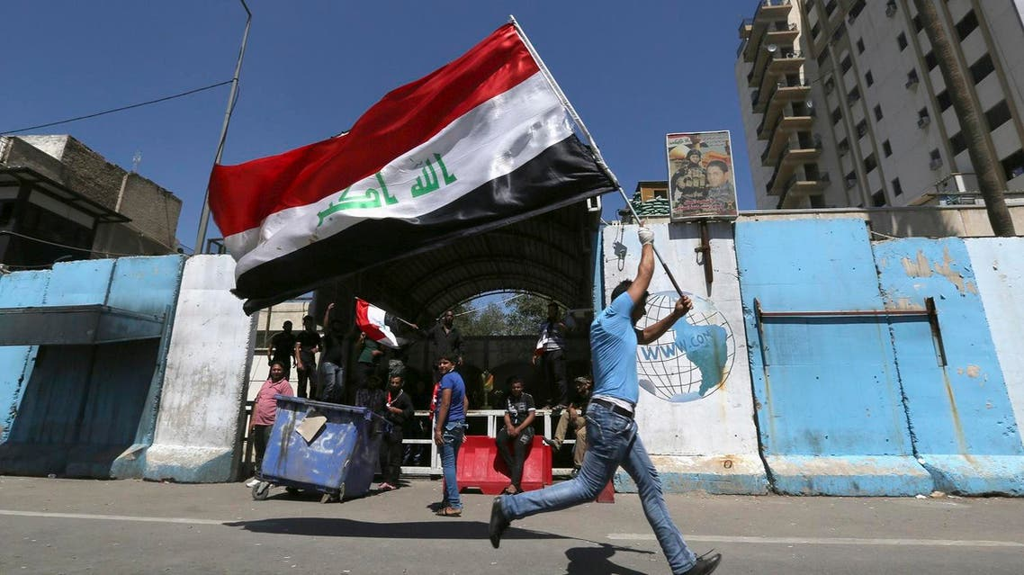 Followers of Shiite cleric Muqtada al-Sadr block the entrance to the communications Ministry in Baghdad, Iraq, Monday, April 18, 2016. More followers joined a rally in central Baghdad to press lawmakers to vote on a Cabinet shakeup proposed by the prime minister amid a simmering political crisis that could jeopardize the country's fight against the Islamic State group. (AP)