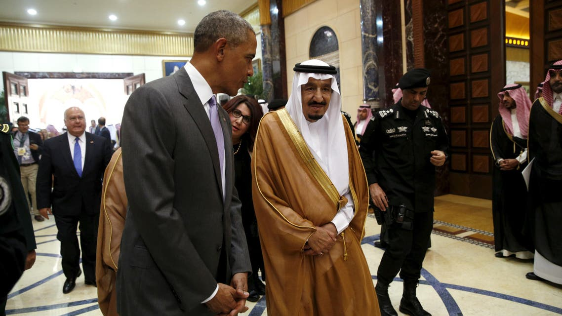 U.S. President Barack Obama walks with Saudi King Salman at Erga Palace upon his arrival for a summit meeting in Riyadh, Saudi Arabia April 20, 2016.