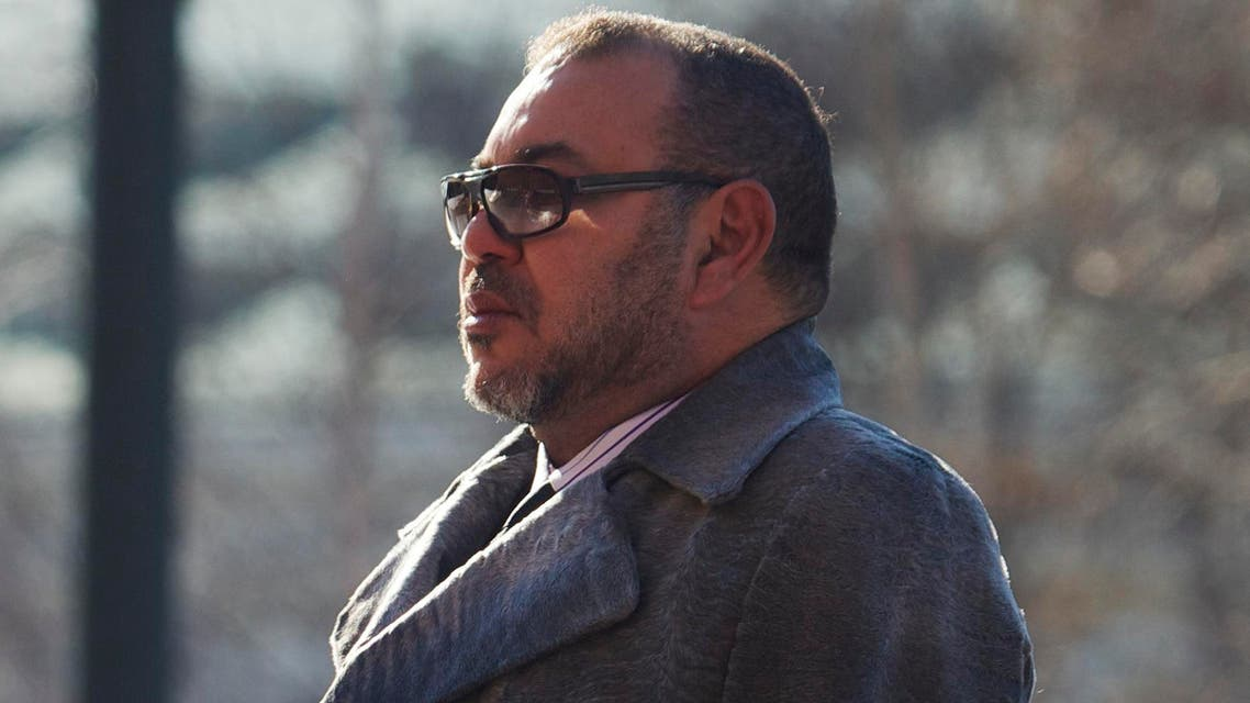 Morocco's King Mohammed VI listens to the national anthem during the wreath laying ceremony at the Tomb of Unknown Soldier outside Kremlin wall in Moscow, Russia, on Tuesday, March 15, 2016. (AP)