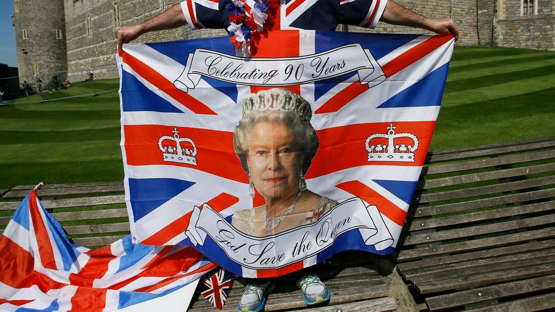 John Loughrey, a royal fan displays a flag in Windsor, England, Wednesday, April 20, 2016. Royal fans are gathering in Windsor ahead of Thursday's celebrations for the 90th birthday of Britain's Queen Elizabeth II. (AP)