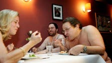 Would you wait with 11,000 other people to dine naked at a restaurant?