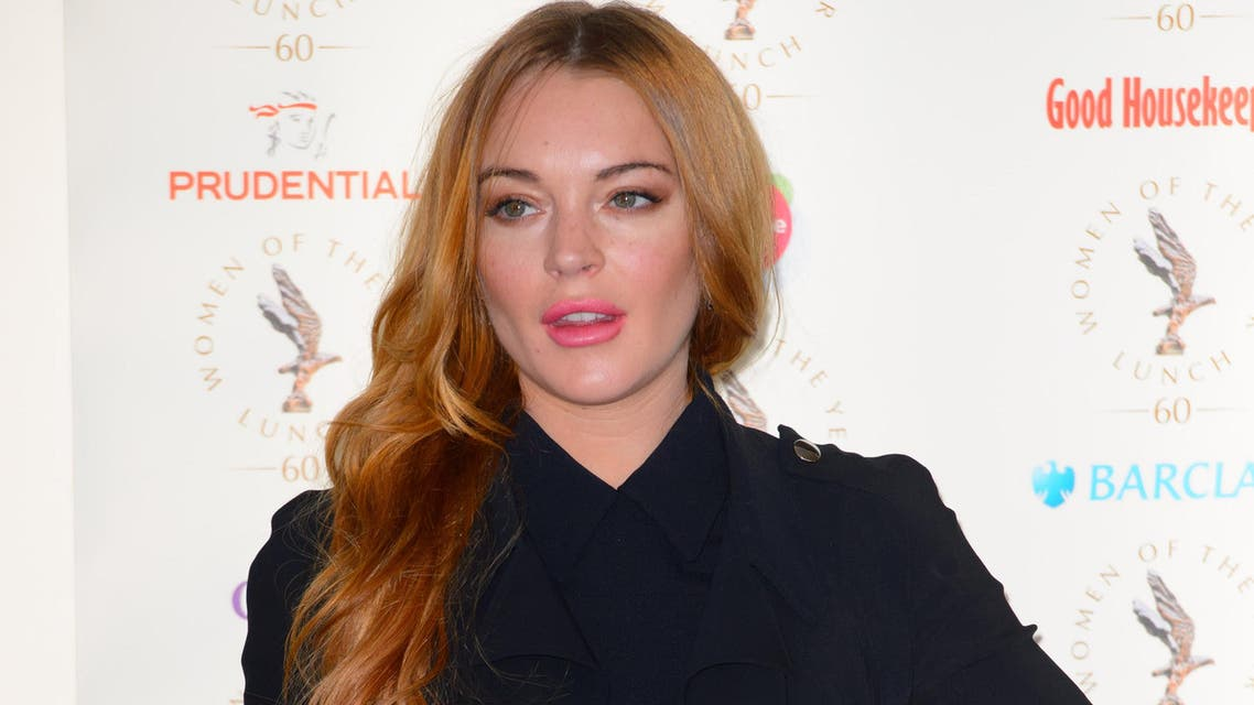 Lindsay Lohan arrives for the Women of the Year Awards at a central London venue, London, Monday, Oct. 13, 2014. (AP)