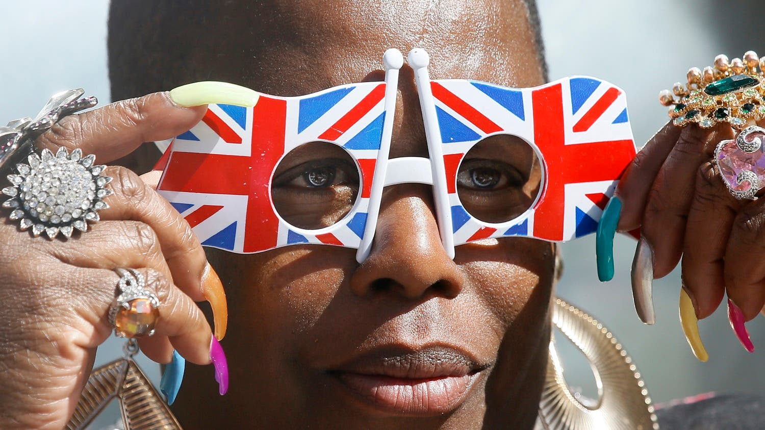 A royal fan adjusts her Union flag glasses, in Windsor, England, Wednesday, April 20, 2016. Royal fans are gathering in Windsor ahead of Thursday's celebrations for the 90th birthday of Britain's Queen Elizabeth II. (AP)