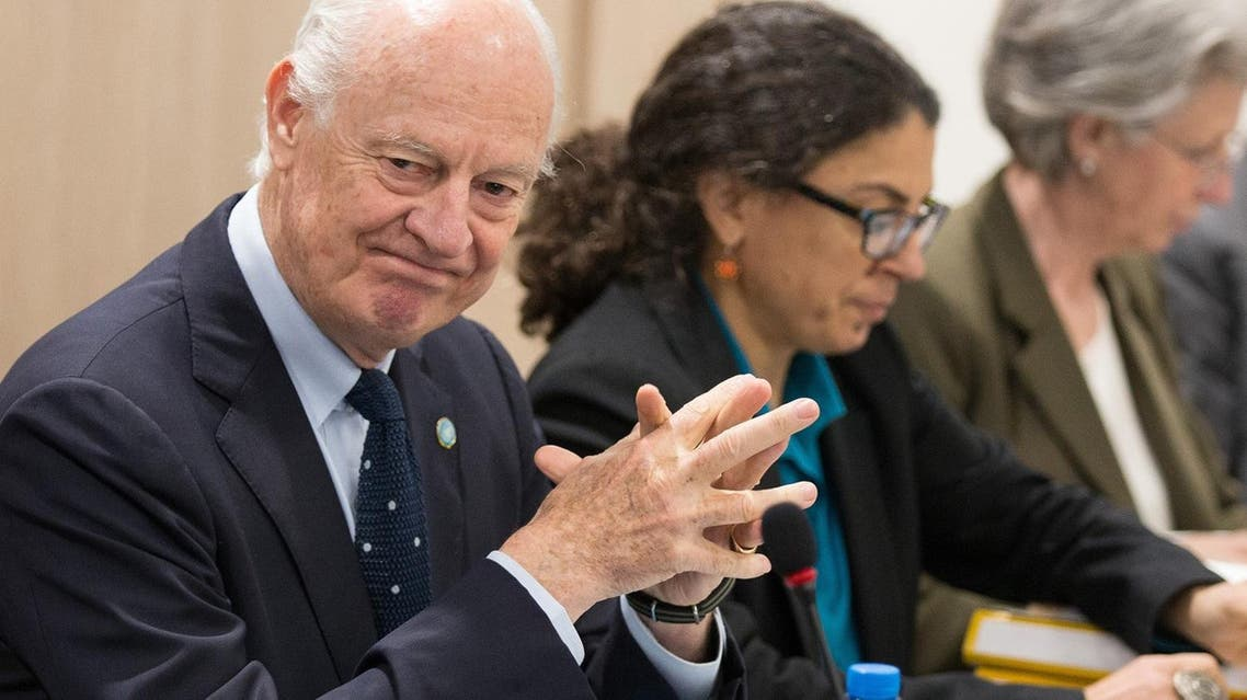 UN special envoy Staffan de Mistura, left, attends a meeting at Palais des Nations in Geneva, Switzerland, Monday, April 18, 2016. A new round of the Intra-Syria talks enters into second week with UN special envoy de Mistura holding separate discussions with government delegation and HNC delegation Monday. (Xu Jinquan/Pool Phjoto via AP))