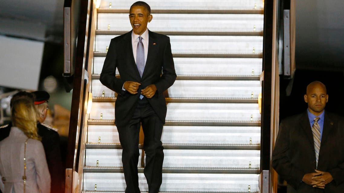 President of the United States Barack Obama smiles as he walks down the steps of Air Force One on his arrival at Stansted Airport, England, Thursday, April 21, 2016. (AP)