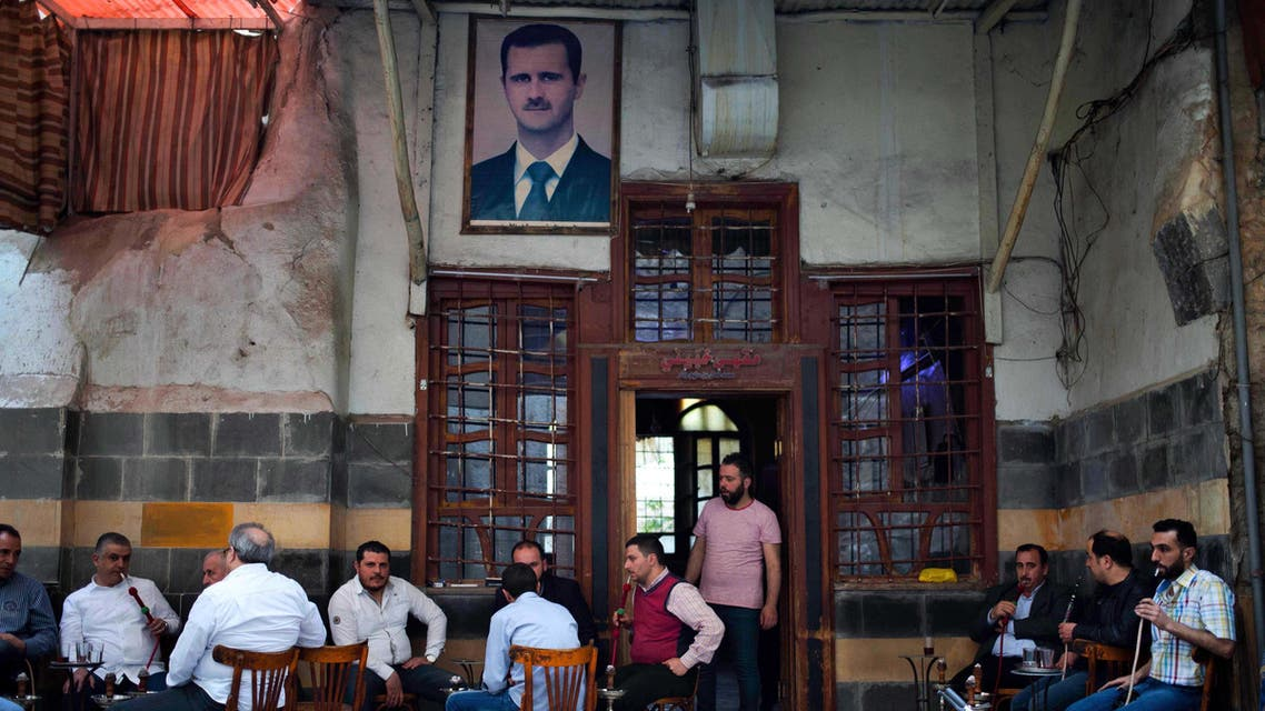 In this Saturday, April 16, 2016 photo, Syrians smoke water pipes at a coffee shop at the Hamidiyeh market, in the Old city of Damascus, Syria. AP