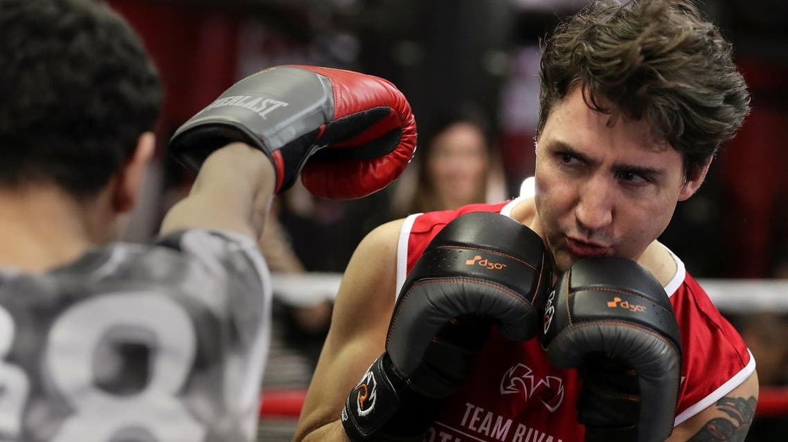 Canadian Prime Minister Justin Trudeau dodges a punch as he spars in the ring at Gleason's Boxing Gym in the Brooklyn borough of New York, US, April 21, 2016. (Reuters)