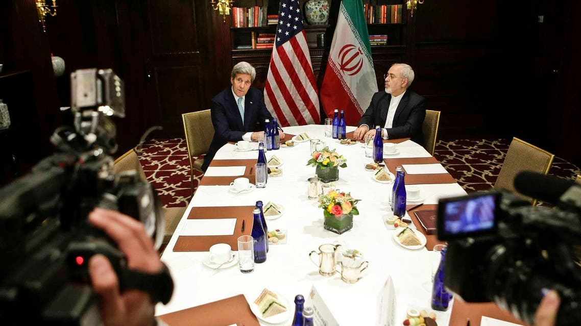 U.S. Secretary of State John Kerry, left, speaks to the media as he meets with Iranian Foreign Minister Mohammad Javad Zarif, right, Friday, April 22, 2016, in New York. (AP Photo/Frank Franklin II)