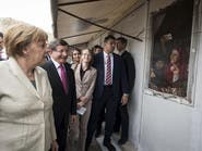 ميركل بتركيا لتهدئة التوتر حول اتفاق إعادة المهاجرين