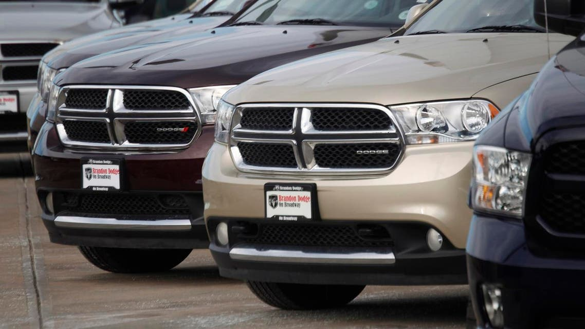 In this Sunday, Jan. 20, 2013, file photo, a line of unsold 2012 Durango sports-utility vehicles sits at a Dodge dealership in Littleton, Colo. Fiat Chrysler is adding more than 467,000 Dodge and Jeep SUVs worldwide to a 2014 recall to fix a potential stalling problem. The company says it's adding 2012 and 2013 Dodge Durangos and 2011 Jeep Grand Cherokees outside North America to a recall from September of last year. The Jeeps have diesel engines. (AP)
