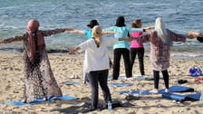 Leaning toward yoga, Tripoli women escape Libya tensions