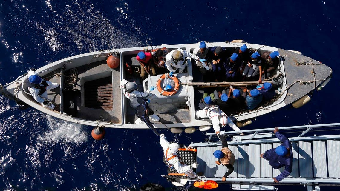In this March 29, 2016 picture migrants get help by Italian sailors to transfer from the German combat supply ship 'Frankfurt am Main' to the their ship 'Grecale' after being rescued during EUNAVFOR MED Operation Sophia in the Mediterranean Sea off the coast of Libya. (AP)