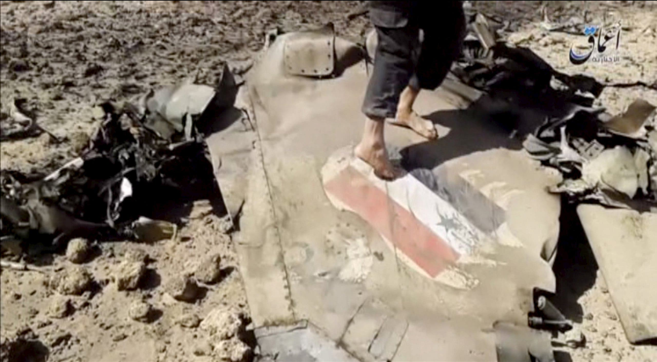 A man walks on the wreckage of a plane that crashed southeast of Damascus, Syria in this still image taken from video said to be shot April 22, 2016. (Reuters)