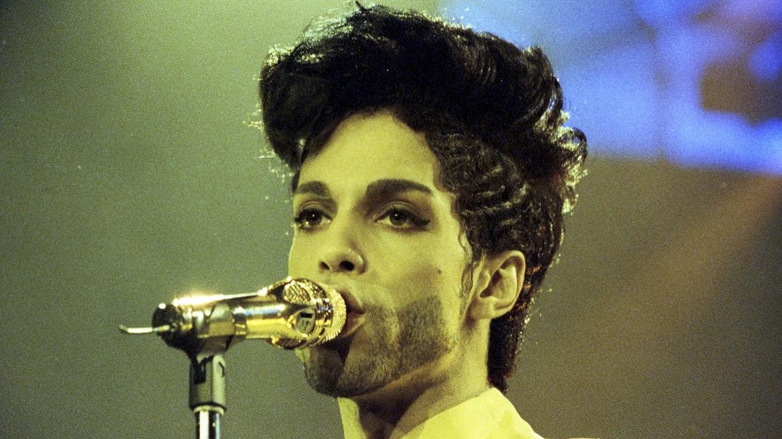 Prince performs during his 'Diamonds and Pearls Tour' at the Earl's Court Arena in London, Britain, June 15, 1992. REUTERS